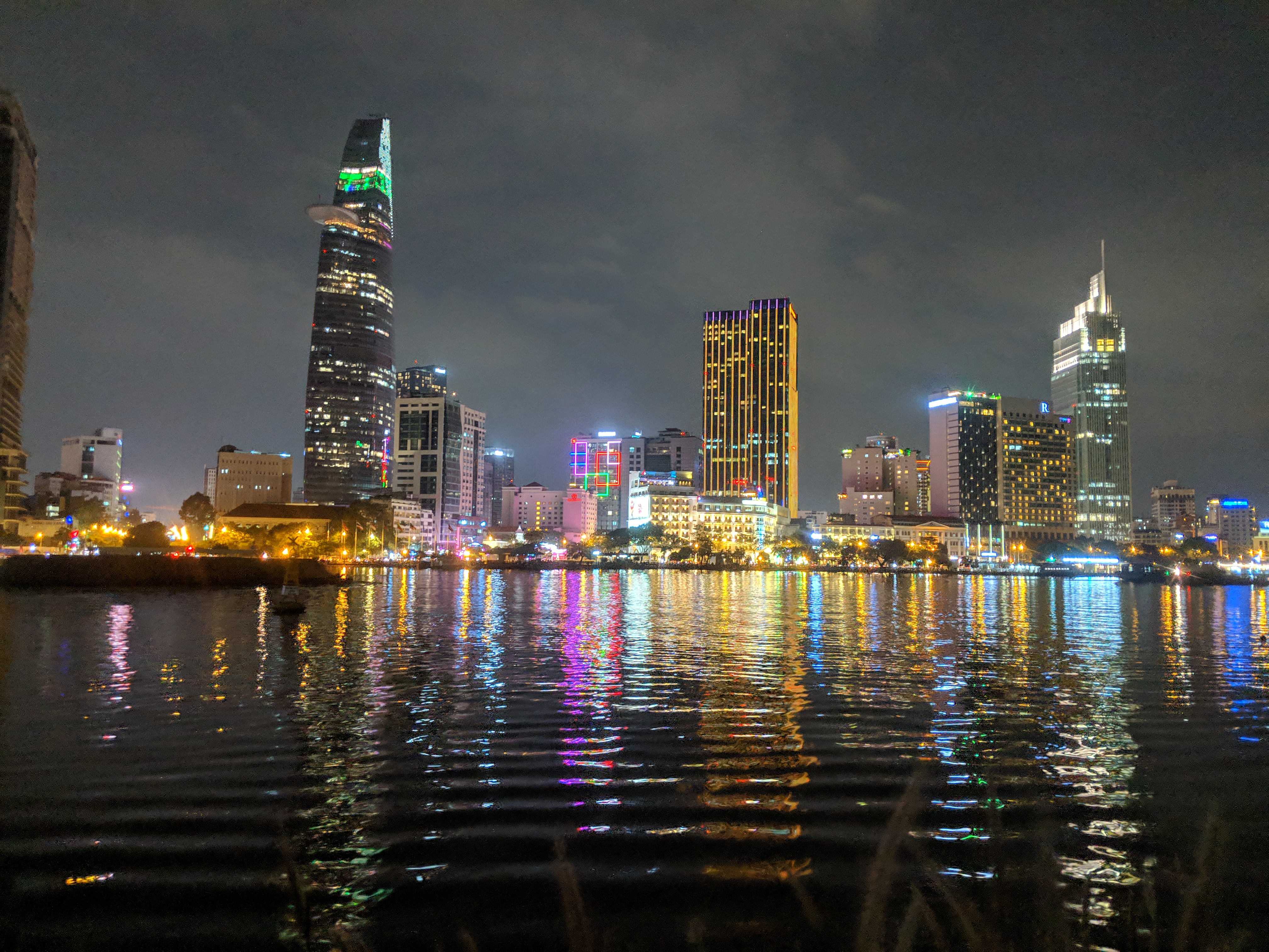 ho chi mind saigon skyline with lake