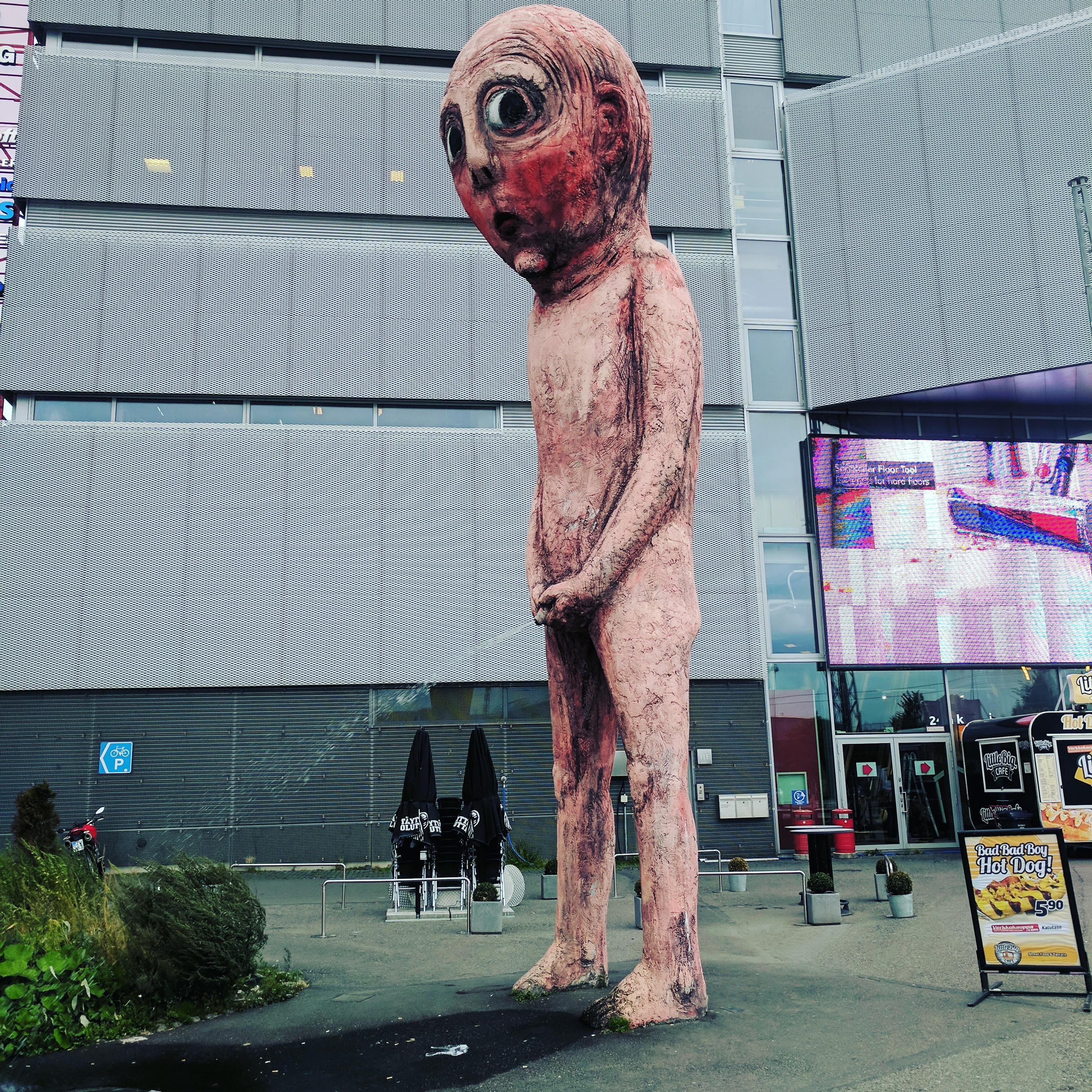helsinki finland public art statue man peeing