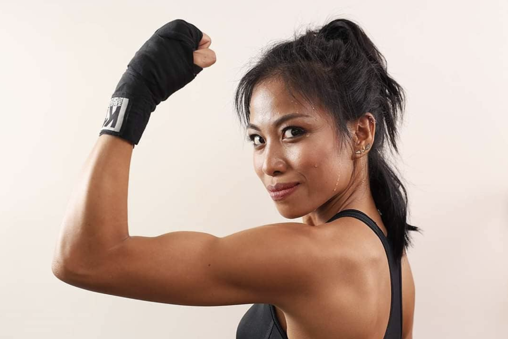 fit filipina woman lady biceps